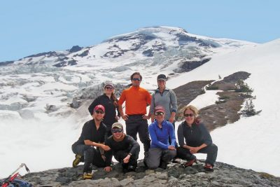 Group posing in front of Coleman Glacier