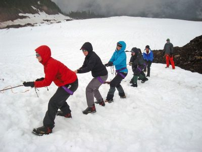 Emergency rescue techniques were included as part of the group's training in alpine travel. Here, the team tests the strength of a snow anchor that held the weight of the entire group.
