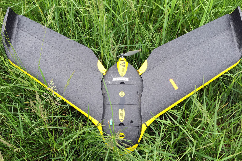 The eBee is a fixed-wing unit weighing 1.5 pounds and measuring 38 inches across.