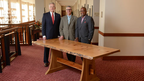 The Legacy Table was dedicated at a ceremony at the Holtzman Alumni Center in April. (left to right): Dean Paul Winistorfer, Professor Earl Kline, and Matthew M. Winston Jr., senior associate vice president for alumni relations.