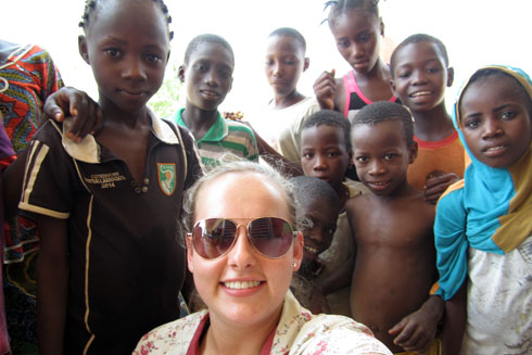 Paige Williams with a group of African children